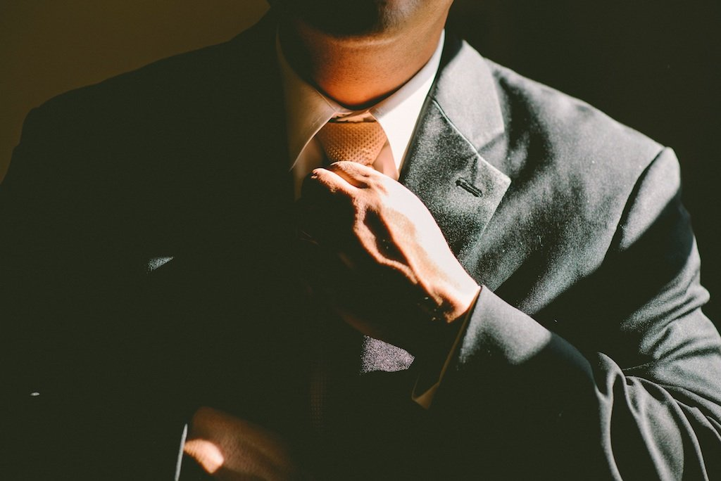 personal injury lawyer, Ryan Malnar adjusting tie to handle your case in Old Colorado City, Downton colorado springs