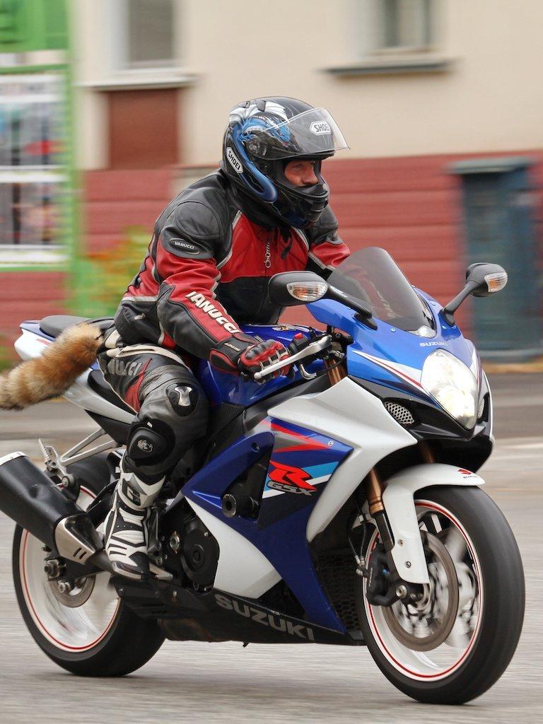 man on motorcycle that got in a car accident needing Malnar's services in Aurora, Pueblo, San Isabel