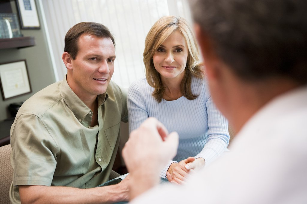 couple receiving a free consultation at Malnar Law Firm in Pueblo, Centennial, Englewood