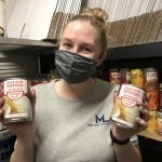 Malnar law team member holds donation food for silver key