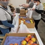 Malnar team packing apples at silver key in colorado springs