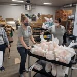 Malnar team wheeling bags of food for the community